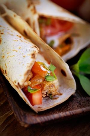 fajita: Mexican food. Fresh tortilla frajita wraps with chicken and vegetables Stock Photo