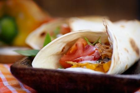 fajita: Mexican food  Fresh tortilla frajita wraps with chicken and vegetables