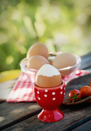 Healthy food- Breakfast with boiled eggs on wood. photo