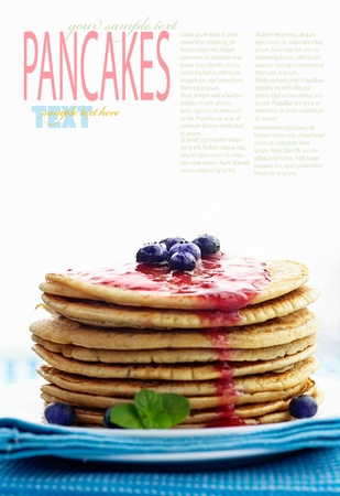 Breakfast food. Pancakes with jam and blueberries isolated on white. photo
