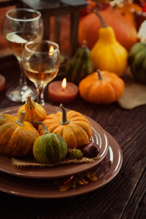 Restaurant autumn table setting. Place setting with oriental plates and autumn decoartion. photo