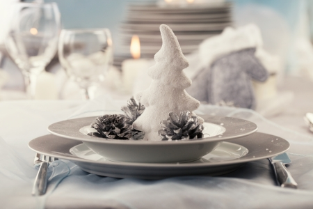 christmas catering: Christmas table setting. Restaurant place setting in elegant holiday style with xmas ornaments