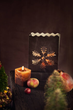 Christmas rustic decoration. Christmas tree, candles and presents photo