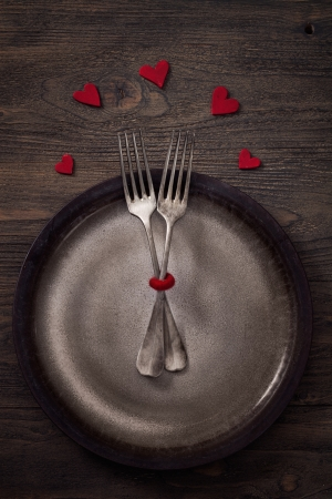 dinner table: Valentines day dinner with table setting in rustic wood style with cutlery