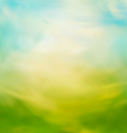 Spring or summer abstract nature background with meadow and blue sky in the back Stock Photo