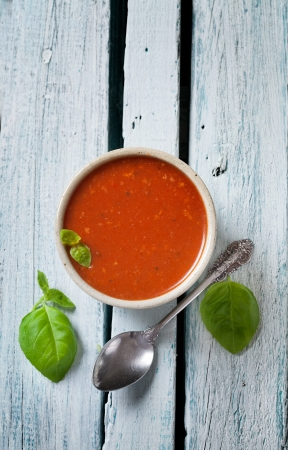 Tomato soup in rustic setting