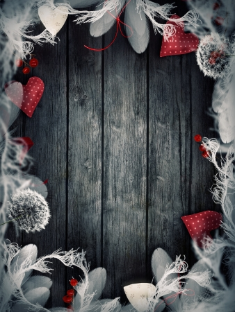 Valentines ornaments on wood with hearts and ribbons. photo