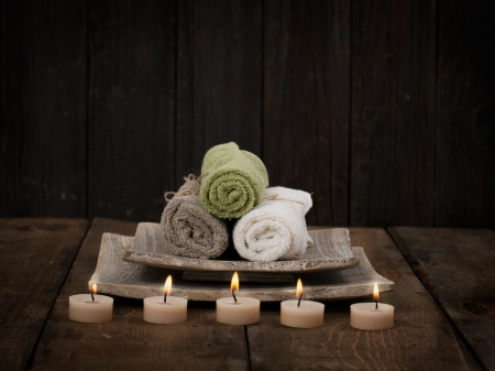 dayspa: Spa and wellness setting with natural soap, candles and towel. Wooden dayspa nature setting Stock Photo