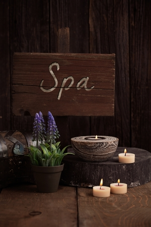 Spa and wellness setting with natural soap, candles and towel. Wooden dayspa nature setting Stock Photo