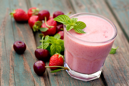 Healthy organic food. Strawberry fruit drink smoothie Stock Photo - 25832619