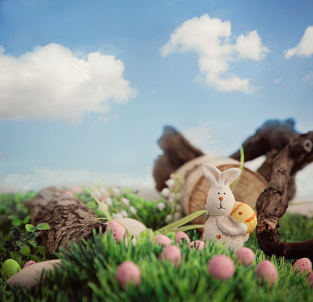 Colorful Easter eggs. Holiday nature concept with easter hunt. Eggs in the sunny meadow photo