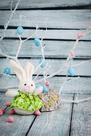 Colorful Easter eggs. Holiday nature concept with easter bunny. Easter background photo