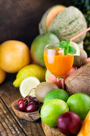 Fruit juice  Organic Fruit variety on wood  Tropical exotic food concept  photo