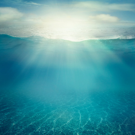 water on surface: Summer background. Underwater sea view. Ocean water surface.