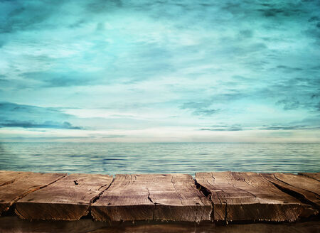 Wood table and tropical landscape in the background.. Spring or summer abstract nature background.  photo