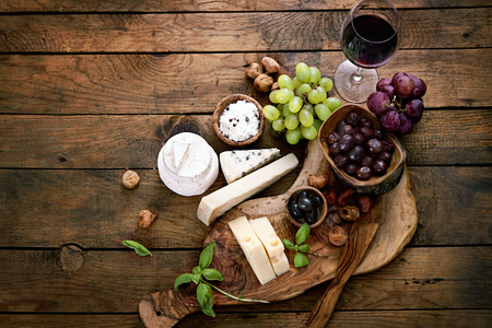 food table: Cheese variety. Food background.  Fresh ingredients on wood