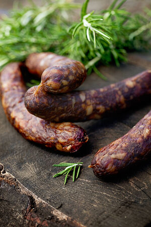 Chorizo sausages. Dried sausages on wood. Rustic sausages photo