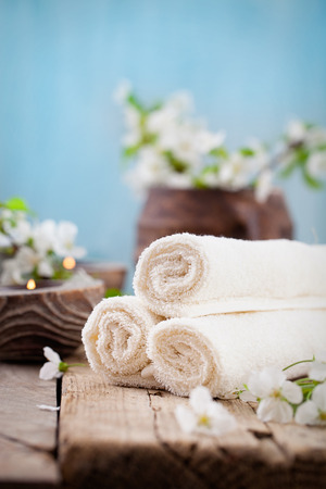 Spa and wellness setting with natural soap, candles and towel. Beige dayspa nature set with copyspace Zdjęcie Seryjne
