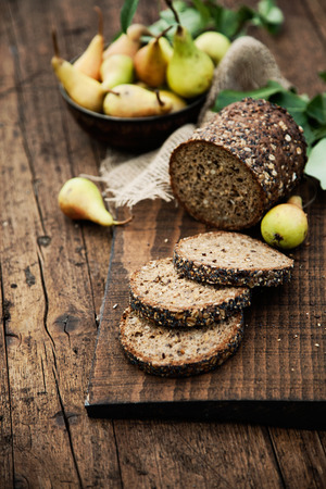 Fresh healthy bread on wood. Breakfast with bread and fruit photo