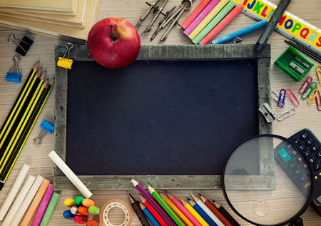 pencil sharpener: School objects for students. Chalkboard, pencils, crayons and apple