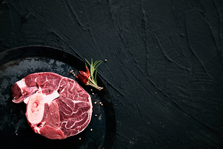 raw: Meat. Raw meat steak black with herbs Stock Photo