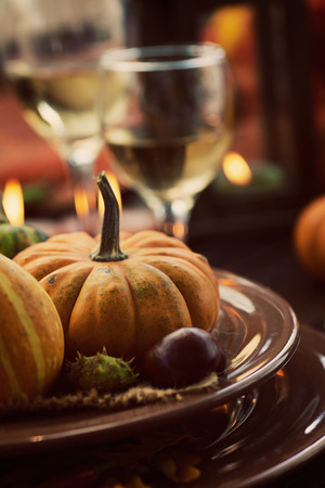 Autumn table setting with pumpkins.  Thanksgiving dinner and autumn decoration. photo