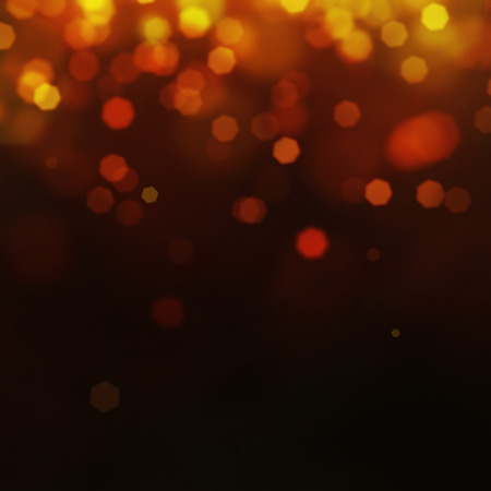 Gold Festive Christmas background. Elegant abstract background with bokeh defocused lights and stars