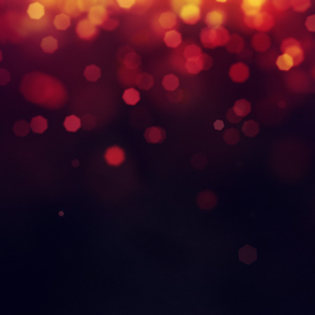 Purple Festive Christmas background. Elegant abstract background with bokeh defocused lights and stars Banco de Imagens