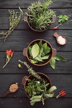 mediterranean food: Mediterranean herbs and  ingredients: rosemary, thyme, sage, salt, oregano