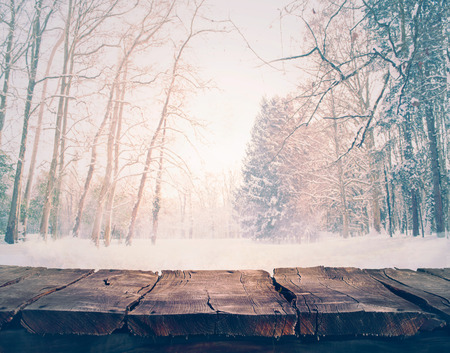 forest wood: Winter snow landscape with wooden table