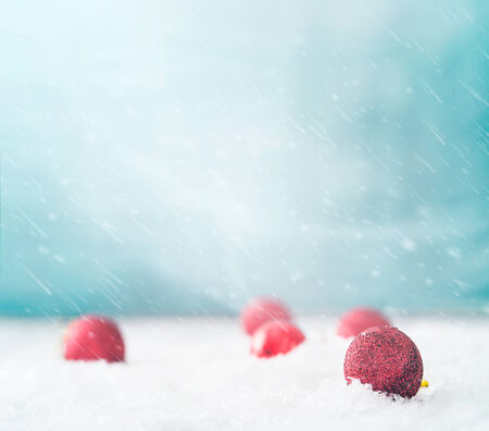 Xmas baubles on snow. Abstract background photo