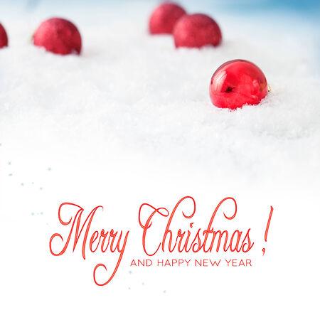xmas background: Christmas background. Xmas baubles on snow.