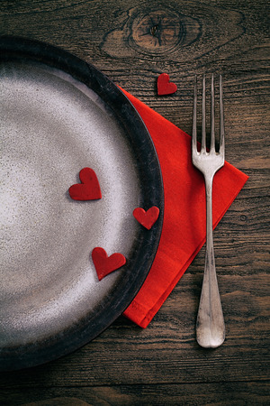 Restaurant series. Valentines day dinner with table setting in rustic wood style with cutlery