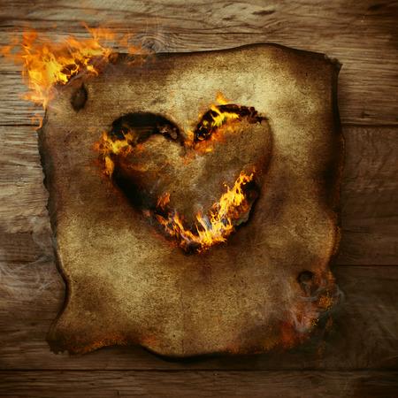 Valentines achtergrond. Hart in vuur en vlam. Brandend hart op papier. Valentines wenskaart