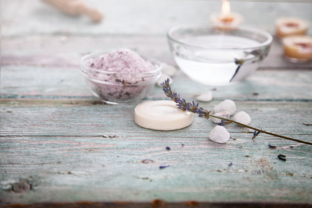 natural setting: Spa and wellness setting with lavender flowers, floral water and bath salt. Dayspa nature set