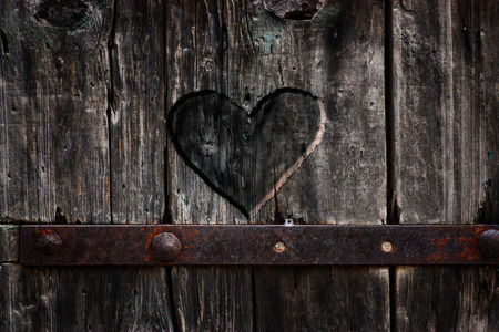 wood carving door: Heart carved in wood. Dark heart. Valentines day background Stock Photo