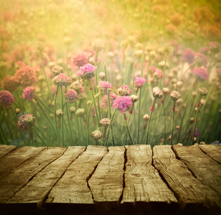 easter morning: Spring background with tabletop. Flowers background. Wood table