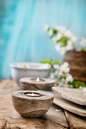 spa therapy: Spa and wellness setting with natural soap, candles and towel. Beige dayspa nature set with copyspace Stock Photo