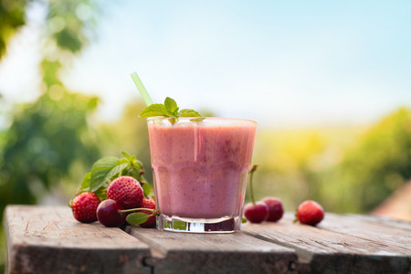 pink cherry: Healthy organic food. Strawberry fruit drink smoothie