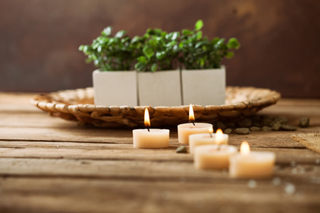 dayspa: Spa and wellness setting with flowers and candles Stock Photo