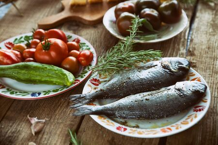 gilt head: Healthy eating. Bream fish preparation. Seafood with vegetables Stock Photo