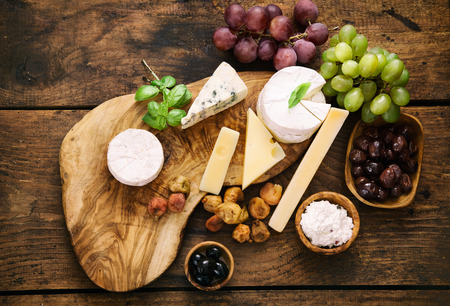 cottage cheese: Cheese variety.Food background.  Fresh ingredients on wood Stock Photo
