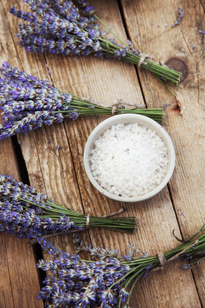 dayspa: Spa and wellness setting with lavender flowers, floral water and bath salt. Dayspa nature set