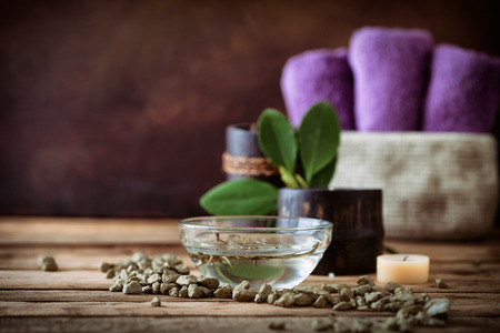 health and wellness: Spa and wellness setting with oils and plants