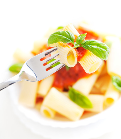 pasta isolated: Pasta with Tomato Sauce and Basil on a Fork