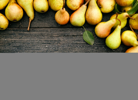 Fresh organic pears on old wood