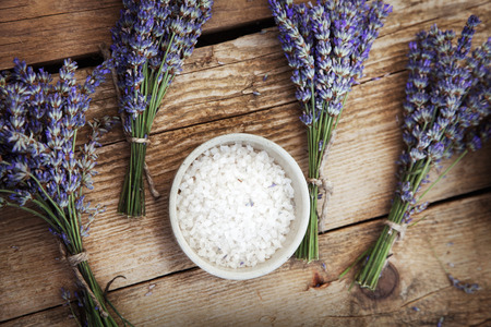 wellness: Spa and wellness setting with lavender flowers, floral water and bath salt. Dayspa nature set
