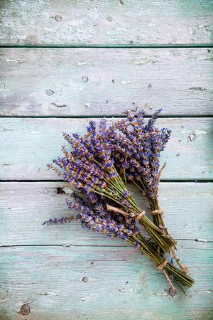 flower bunch: Lavender background. Lavender flower bunch on wood. Floral background Stock Photo