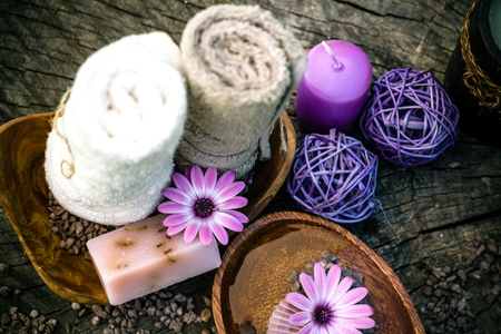 dayspa: Spa and wellness setting with natural soap, candles and towel. Violet dayspa nature set dayspa nature set Stock Photo