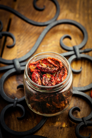 dried food: Vegetarian food. Sun dried tomatoes with herbs and garlic. Italian food vegetables Stock Photo